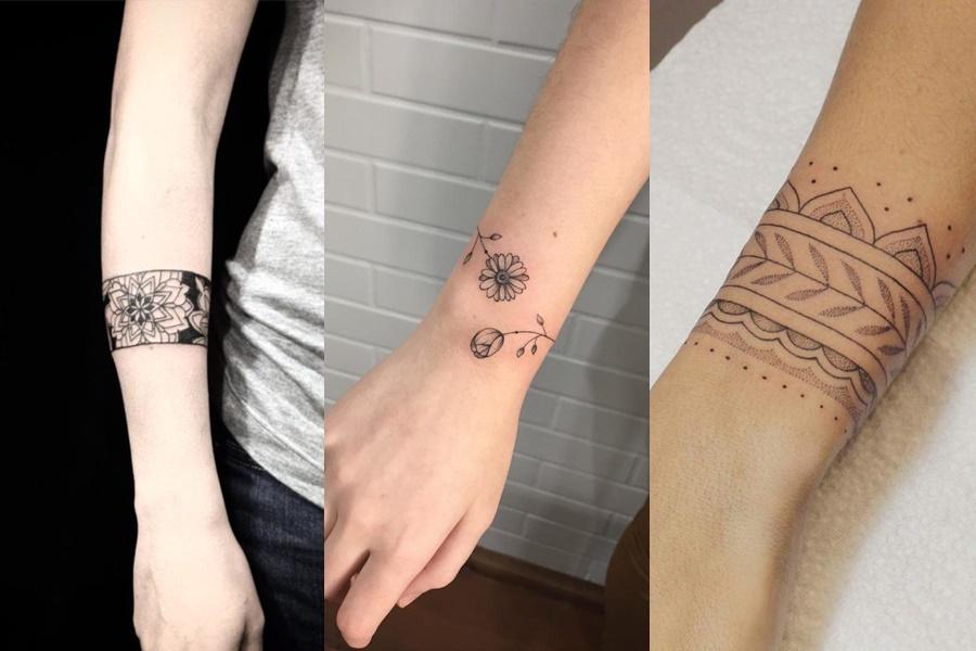 tatuagem feminina no braço estilo bracelete