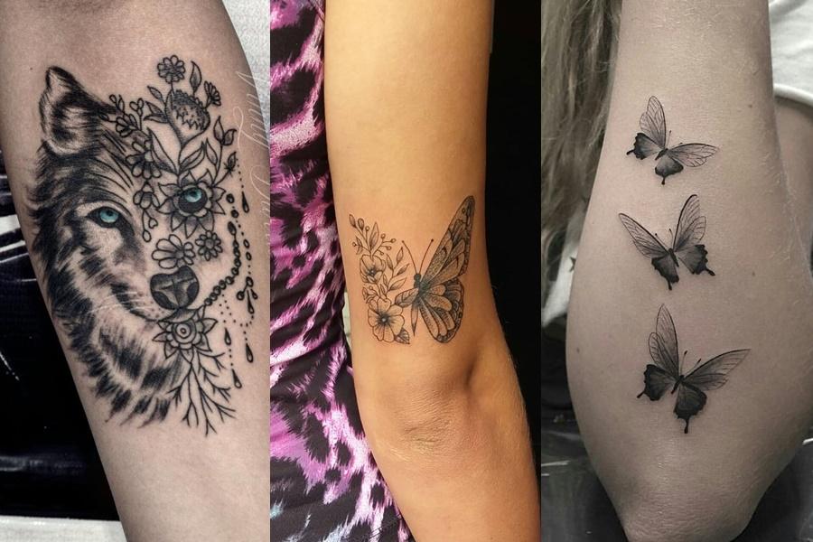 tatuagens femininas de animais no braço ( borboleta e lobo)
